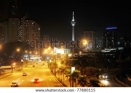 night view of Kuala Lumpur downtown with the KL Tower - stock photo
