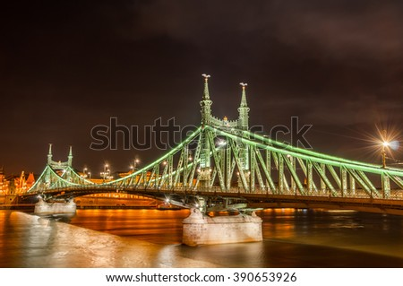 Night view of Liberty Bridge (Freedom Bridge) in Budapest, Hungary, connects Buda and Pest across the River Danube. - stock photo