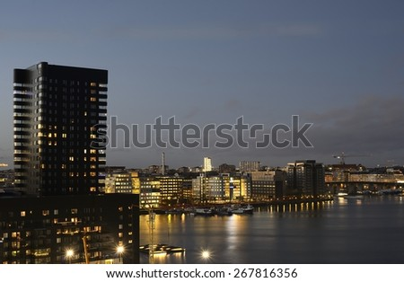 Night view of Liljeholmen and the Southern part of Stockholm. - stock photo