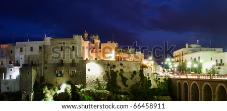 "Night view of little village ""Polignano a mare"" with bridge - stock photo"