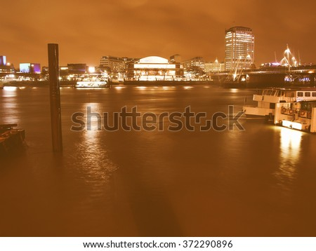 Night view of London South Bank with Royal Festival Hall and National Theatre vintage
