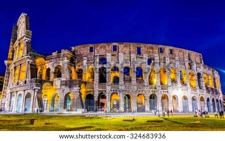 night view of majestic colloseum in rome. - stock photo