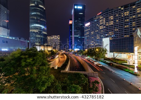 Night view of Mingzhuta Road in downtown, the Pudong New District (Lujiazui) of Shanghai, China. Modern city traffic. Shanghai is a popular tourist destination of Asia and a global financial center. - stock photo