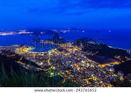 Night view of mountain Sugar Loaf and Botafogo in Rio de Janeiro. Brazil - stock photo