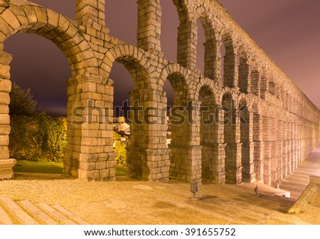 Night view of old roman aqueduct at Segovia. Spain