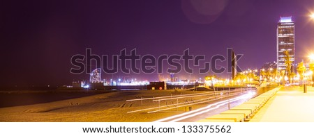 night view of Port Olimpic - center of nightlife at Barcelona, Spain - stock photo