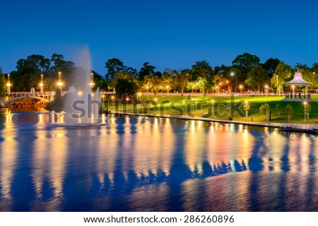 Night view of River Torrens and Fountain in Elder Park. Long exposure effect - stock photo
