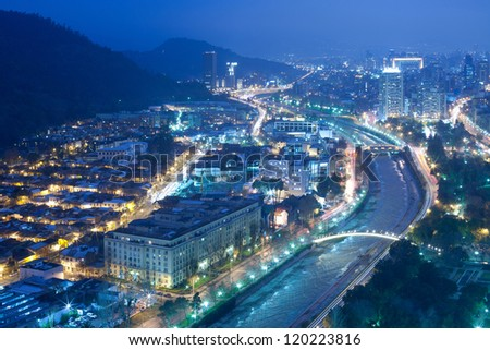 Night view of Santiago de Chile toward the east part of the city, showing the Mapocho river and Providencia and Las Condes districts - stock photo
