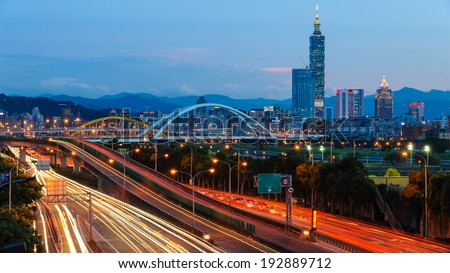 night view of Taipei city with skyscraper and traffic trails - stock photo