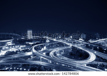 night view of the bridge and city in shanghai china. - stock photo