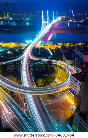 night view of the bridge and city in shanghai china. - stock photo