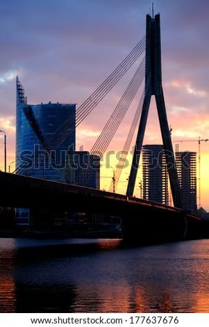 Night view of the bridge over the Daugava river. Riga, Latvia - stock photo