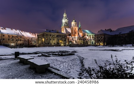 Night view of the cathedral of St Stanislaw and St Vaclav and Royal Castle on the Wawel Hill, Krakow, Poland, covered by the snow.  - stock photo