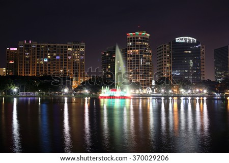 Night view of the city of Orlando with Lake Eola Park. Selective focus - stock photo