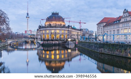 Night View of the famous Bode Museum, River Spree and Berlins TV Tower  - stock photo