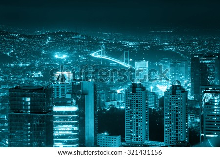 Night view of the illuminated city downtown, skyscrapers and bridge, blue toned, Istanbul, Turkey, Europe - Asia - stock photo