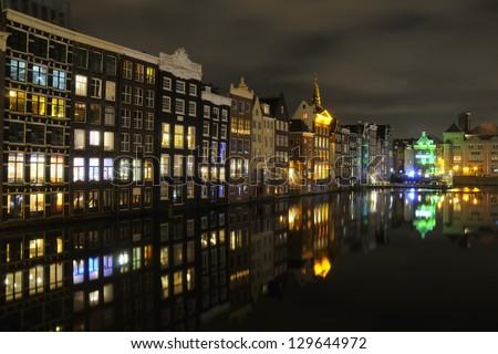 Night view of the neighborhood Damrak in Amsterdam, Holland - stock photo