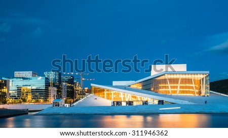 Night View of The Oslo Opera House Is The Home Of The Norwegian National Opera And Ballet. Norway - stock photo