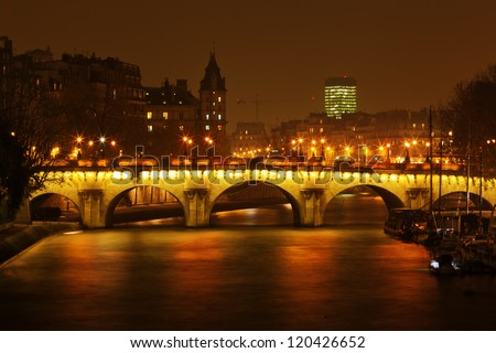 night view of the Pont Neuf and the Il de Cite in Paris - stock photo