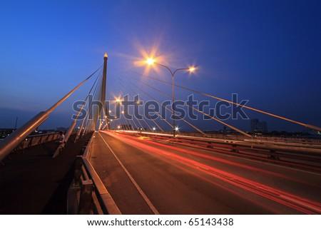 Night view of the Rama VIII bridge over the Chao Praya river (Bangkok, Thailand) - stock photo