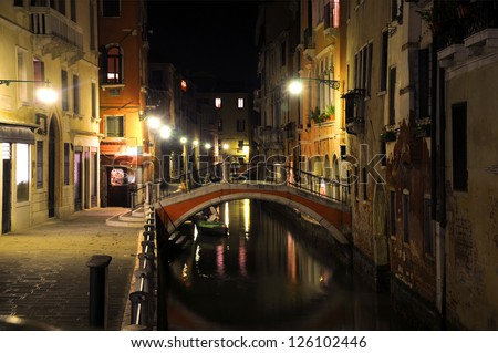 Night view of the street and the canal in Venice