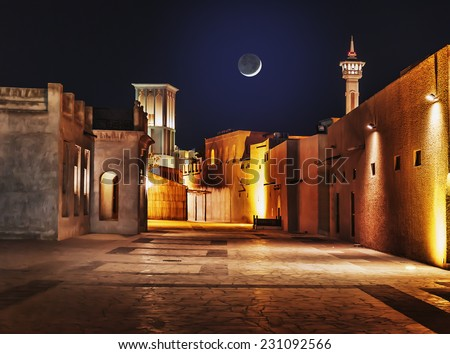 Night view of the streets of the old Arab city Dubai UAE - stock photo