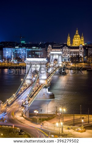 Night view of the Szechenyi Chain Bridge over Danube River and church St. Stephen's Basilica in Budapest, Hungary. View from Royal Palace in Buda Castle. - stock photo