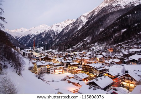 Night view of village in mountains - stock photo
