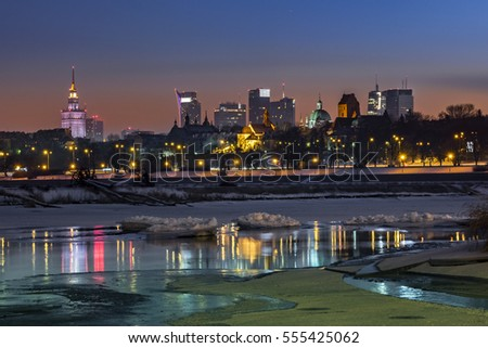 Night view of Warsaw downtown over Vistula river in winter time