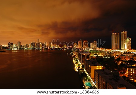 Night view on Aventura from Sunny Isles Beach over Intercoastal Waterway - stock photo