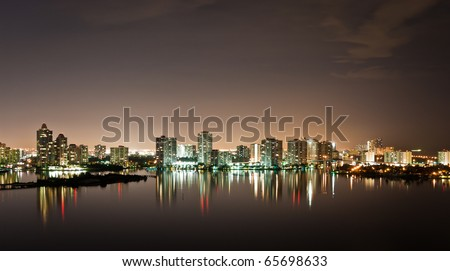 Night view on Aventura from Sunny Isles Beach over Intercoastal Waterway