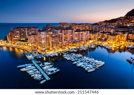 Night view on Fontvieille and Monaco Harbor - stock photo