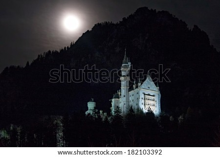 Night view on Neuschwanstein castle with bright full Moon over mountain. Bavaria, Germany.   - stock photo