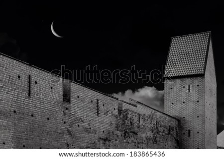 Night view on old fortified wall in old Riga, Latvia. In 2014, Riga is the European capital of culture  - stock photo