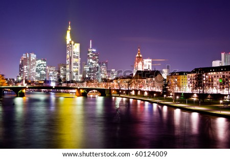 Night view on the Frankfurt skyline with reflections on water - stock photo