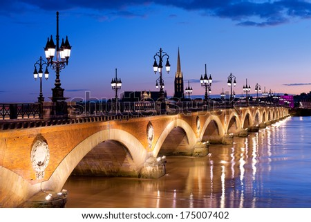 Night view on The Pont de pierre in Bordeaux - stock photo