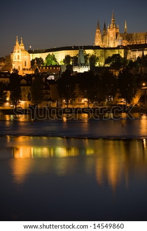 Night view to Lesser Town, Prague castle, St. Nicholas church and Charles bridge.