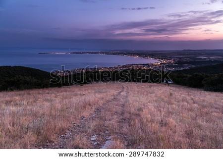 Night view to the coastal city - stock photo