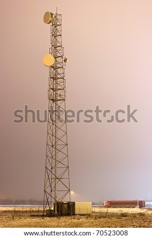 Night view with transmitter and truck - stock photo