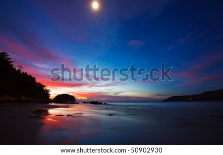Night with moon above the tropcal beach - stock photo