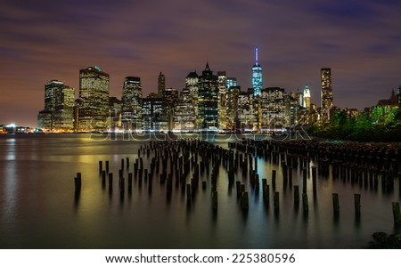 Nightfall on Downtown Manhattan from Brooklyn Bridge Park - stock photo