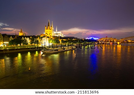 Nightly panorama of Cologne and the river Rhine, Germany. - stock photo