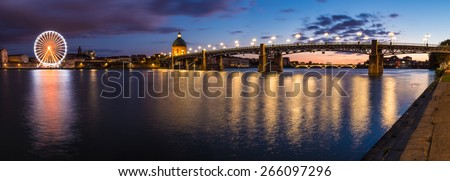 Nightly panorama of the Garonne river bank - stock photo