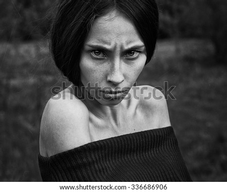 Nightmare and Halloween theme: portrait of scary girl witch , black and white photography - stock photo
