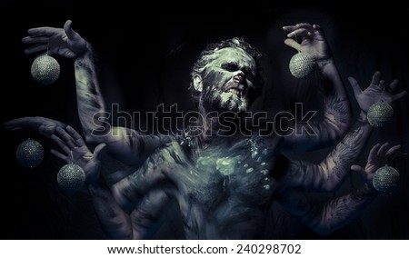 Nightmare, man in mud with six arms - stock photo
