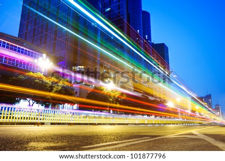 Nightscape Downtown  with  headlights trails of traffic through - stock photo