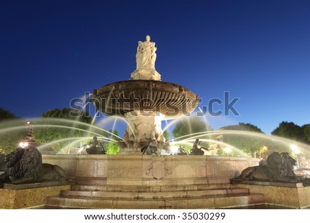 Nightshot of La Rotonde fountain - The central roundabout in Aix-en-Provence, France. - stock photo