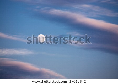 Nighttime sky with moon and clouds. Ideal for background. - stock photo