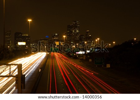 Nighttime traffic heading to Houston Downtown at Night - stock photo