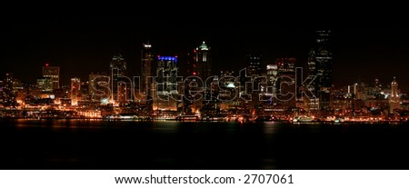 Nighttime view of Seattle's downtown and harbor - stock photo